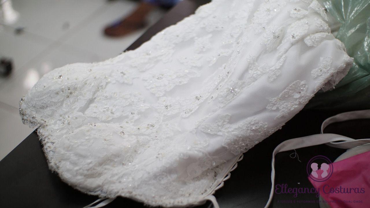 trabalhos-de-costuras-em-vestido-de-noiva-aplicando-pedrarias-6990112
