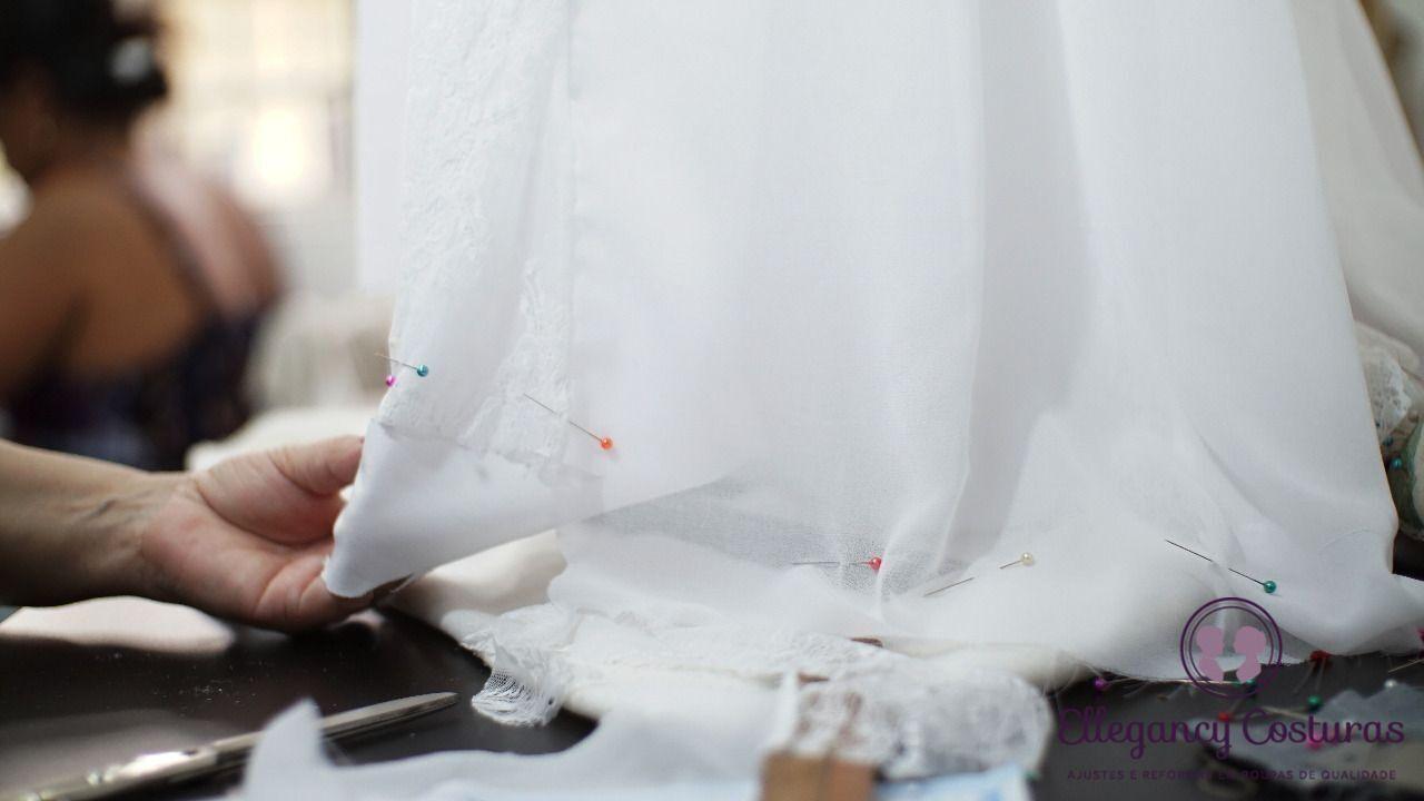 trabalhos-de-costuras-em-vestido-de-noiva-fazendo-barra-9726391